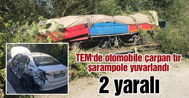 TEM'de otomobile çarpan tır şarampole yuvarlandı